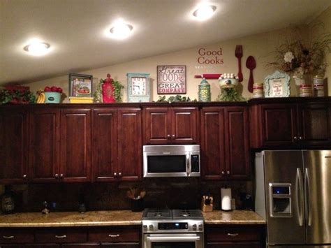 decorating ideas for top of kitchen cabinets how to decorate on top of cabinets with vaulted ceiling