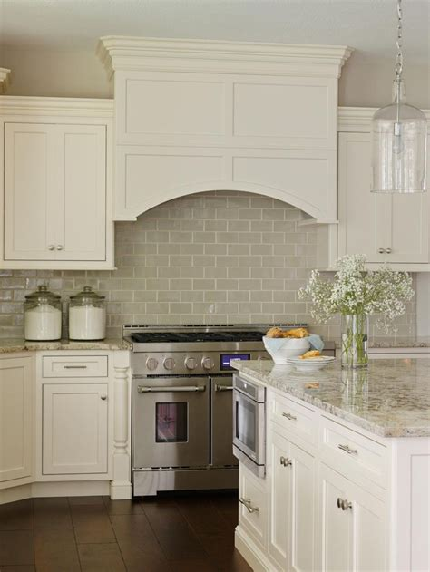 white backsplash kitchen white cabinetry paired with a glossy neutral tile