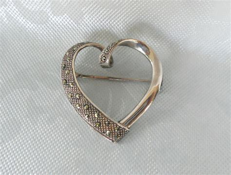 Vintage 1980s Sterling Silver Heart Shaped Marcasite. Field Watches. Top Necklace. Wholesale Earrings. Catalyst Platinum. Baguette Eternity Band Platinum. Buy Women's Jewelry Online. Hand Crafted Wedding Rings. Tsavorite Engagement Rings