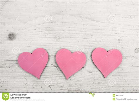 pink hearts   wooden white shabby chic background stock photo image