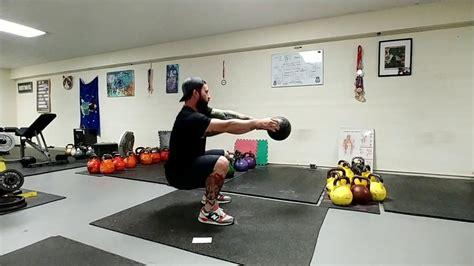kettlebell heavy swing arm squats speed