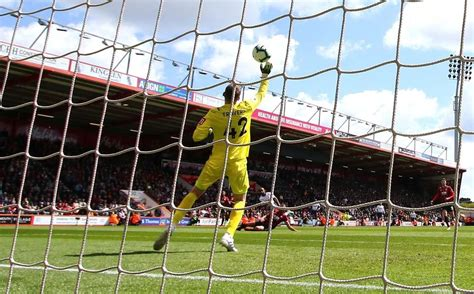 Bournemouth goalkeeper Travers enjoying competition for ...