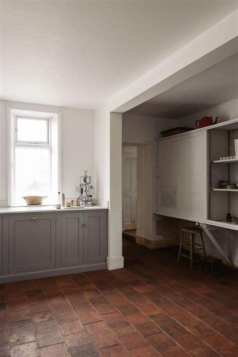 Grey Cupboards Kitchen by White Walls Grey Cupboards And Quarry Tiles In Devol