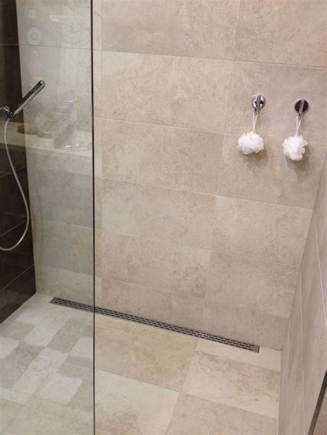 curbless shower floor slope google search shower floor tile room tiles design shower floor