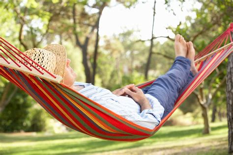 Relaxing On Hammock by Create A Backyard Retreat With These 5 Items