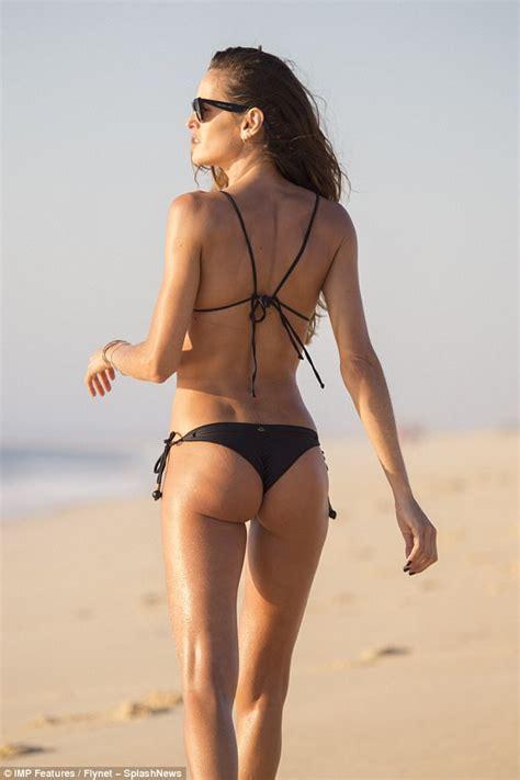 Izabel Goulart flaunts her peachy derriere in tiny bikini ...