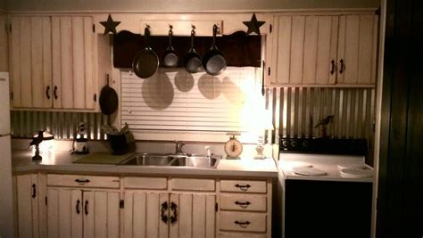 tin backsplash  white barn wood cabinets  vintage