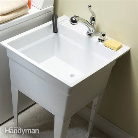 kitchen faucet with sprayer and soap dispenser upgrade your laundry sink the family handyman
