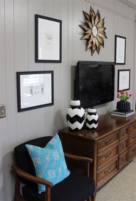 They can also be a clever way to cover your television if you don't want to worry about tv wall decor. LAST PICTURES OF UMCH.... - design indulgence