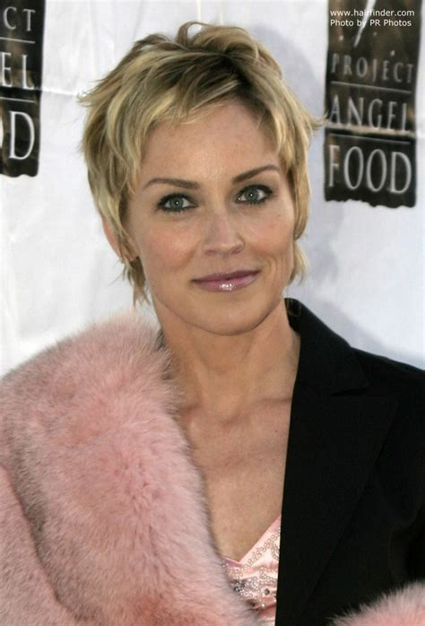 Sharon Stone wearing her hair short in a layered pixie