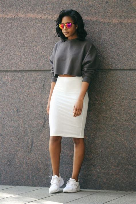A gray sweatshirt white pencil skirt and sneakers ...