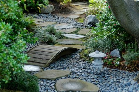 outdoor pottery plants pebbles pavers  hardscapes