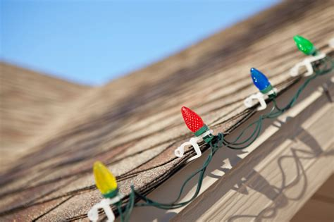 how to hang christmas lights 3 tips for hanging christmas lights on your roof without