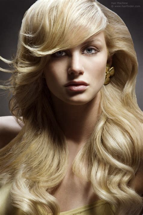long flowing hairstyles long flowing blonde hair styled into smooth cascading waves