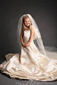 a little girl dresses up in her mother39s wedding dress With wedding dresses for little girl