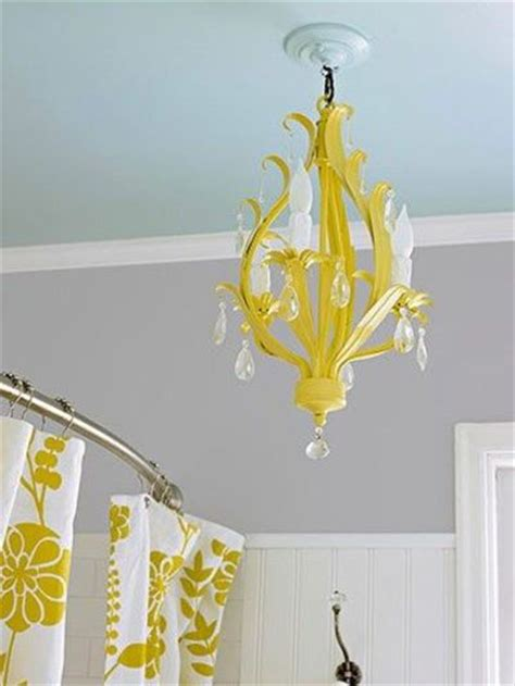 love  blue ceiling grey wall  yellow chandelie
