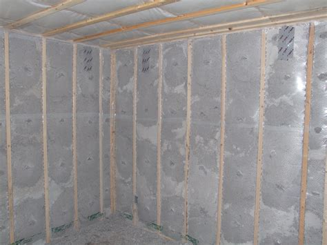 Framing Concrete Basement Walls by Insulation Installation Achieves Resnet Grade 1 Building