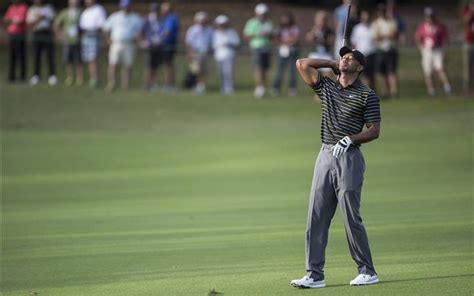 Tiger Woods returns with a 77 at the Hero World Challenge