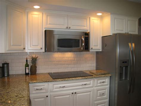 brushed nickel cabinet knobs square same color counter top but with white backsplash