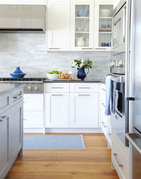 Similarly, shaker style cabinets are versatile enough to accommodate a range of kitchen styles. I like the simple handles and their placement on these ...
