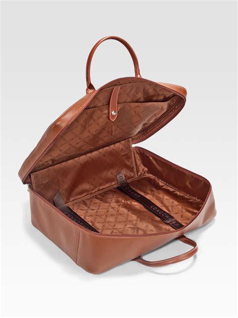 lyst longchamp veau foulonne leather travel bag  brown  men