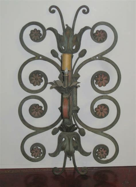 rod iron wall sconces antique wrought iron wall sconce painted flowers 1