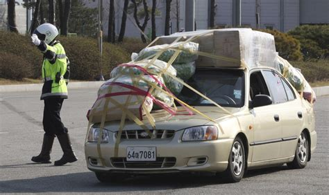 overloaded cars  south korean workers