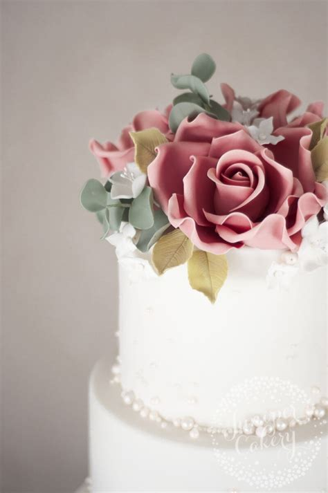 pearl studded wedding cake  dusky pink roses