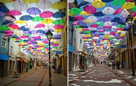 hundreds  umbrellas   float   streets