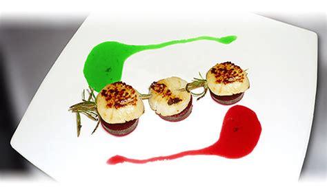 recette cuisine gastronomique brochette de jacques en romarin sur pilotis de