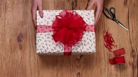 christmas gift wrapping how to make a ribbon pom pom bow