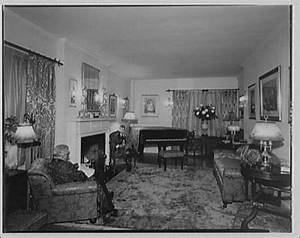 Miscellaneous interiors Living room, to piano with man