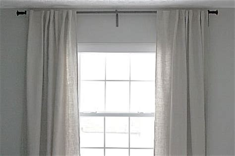 how wide to hang curtain rod quot the edge of the curtain