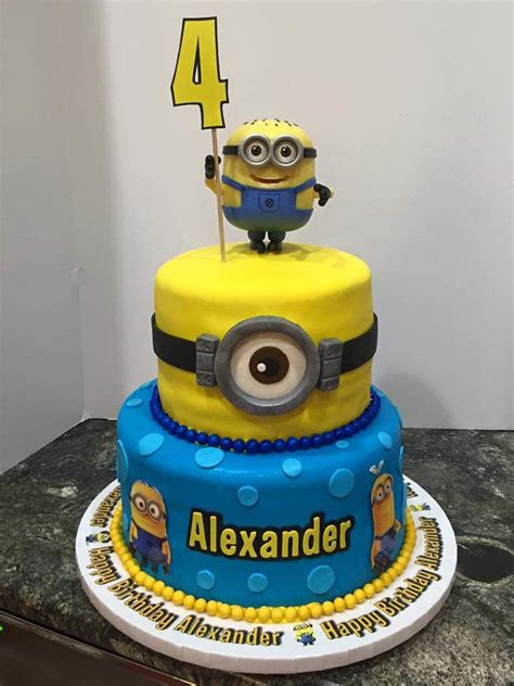 Angie, you are truly the design master of cake and icing. minion 2 tier birthday cake | 2 tier birthday cakes, Minions, Minion birthday
