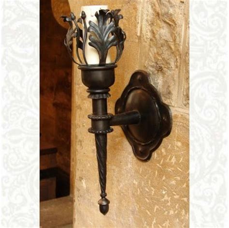 a wall torch sconce that can also be used as a held