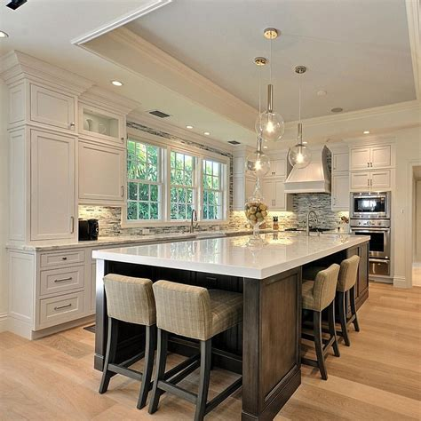kitchen island with beautiful kitchen with large island house home