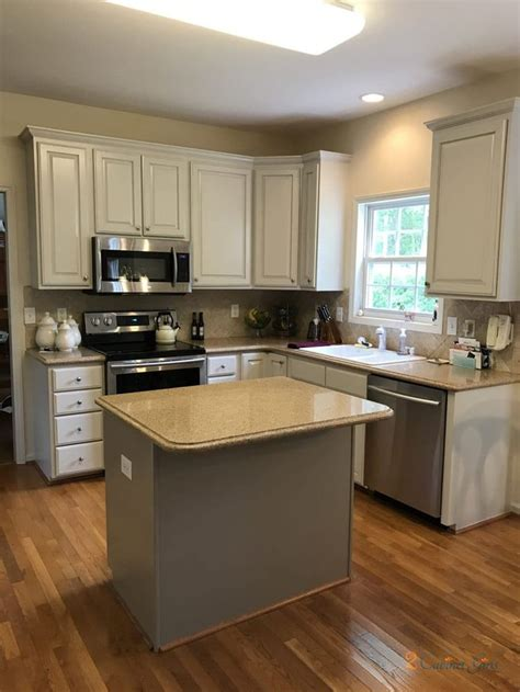 homeowner loves    cream toned cabinets
