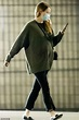 Emma Stone looks cozy in a green cardigan as she heads to ...