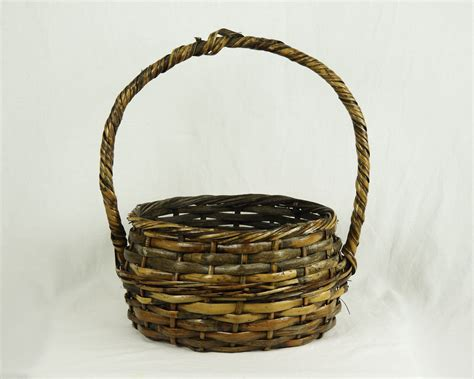 Hanging the baskets on the wall was an art itself. Vintage Gathering Basket, Bamboo & Rattan, Distressed Brown, Solid Wood Handle, Woven Splint ...