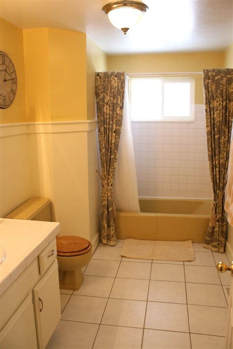 mustard yellow tub  toilet updated bathroom