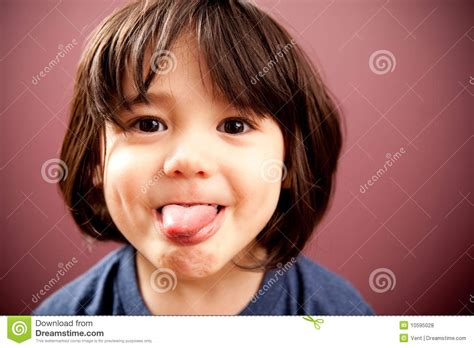 Crazy Funny Kid Sticking His Tongue Out Royalty Free Stock