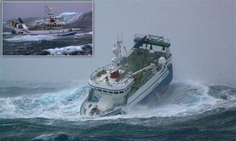 North Sea trawlermen: Fishing boat battered by waves as