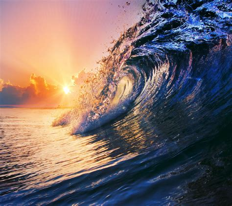 sunset with sea wave tap to see more breathtaking