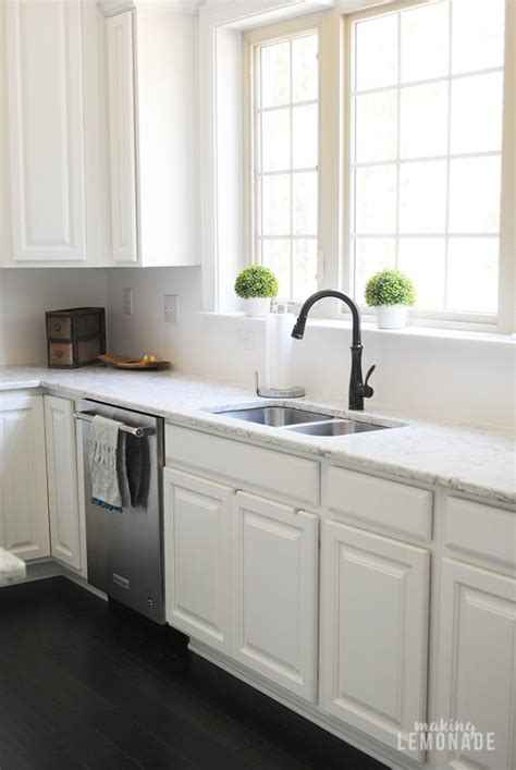 White Cabinets Bronze Hardware by An Easy Kitchen Update That Makes A Difference