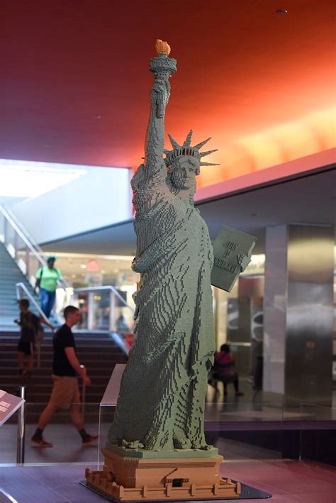 foot lego statue  liberty greets visitors  national museum  american history