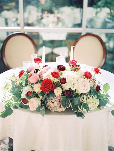 sweetheart table  red  white flowers elizabeth