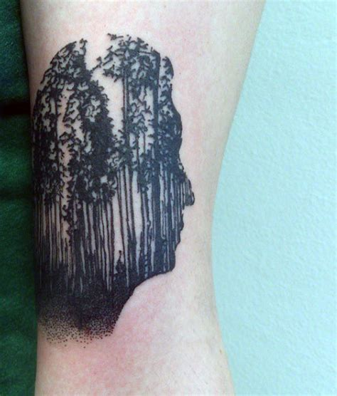 man face  pine trees tattoo  bicep