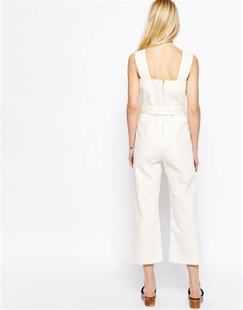 white denim jumpsuit asos denim jumpsuit in white in white lyst