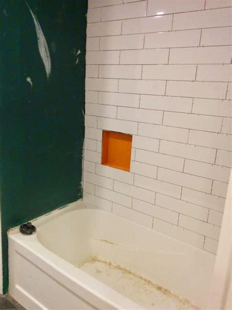 shower design subway tile  marble tile niche