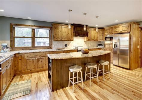 kitchen with travertine floors spacious and open kitchen with hickory cabinets millwork 6556